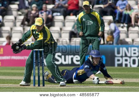 May 03 2009; Southampton Hampshire, Wicketkeeper P Nixon  attempts to run out a diving J Adams  competing in Friends Provident trophy 1 day cricket match played at the Rose Bowl.
