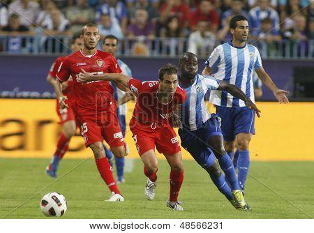 MALAGA, SPAIN. 19/09/2010. Ivica Dragutinovic a Sevilla defender and Quincy Owusu-Abeyie the Malaga forward during the La Liga match between CF Malaga and Sevilla, played in the La Rosaleda Stadium