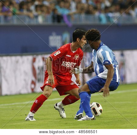 MALAGA, SPAIN. 19/09/2010. Alejandro Alfaro a Sevilla midfield player and Eliseu  Malaga midfielder in action during the La Liga match between CF Malaga and Sevilla, played in the La Rosaleda Stadium