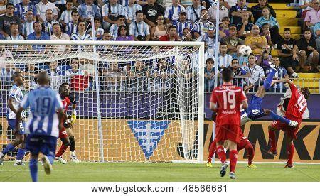 MALAGA, SPAIN. 19/09/2010. Eliseu the Malaga midfielder attempts an overhead kick at goal during the La Liga match between CF Malaga and Sevilla, played in the La Rosaleda Stadium
