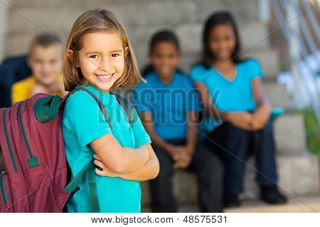 portrait of pretty preschool girl with backpack outdoors