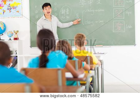 elementary school teacher teaching chinese language in classroom