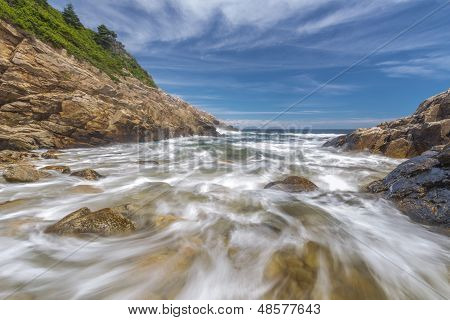 Ocean Waves Crashing Against A Rocky Shore- Slow Shutterspeed