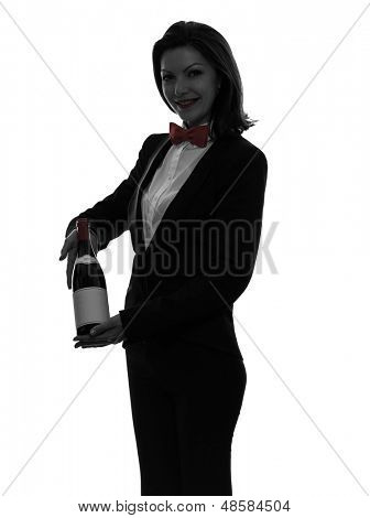 one caucasian woman waiter butler serving red wine in silhouette  on white background