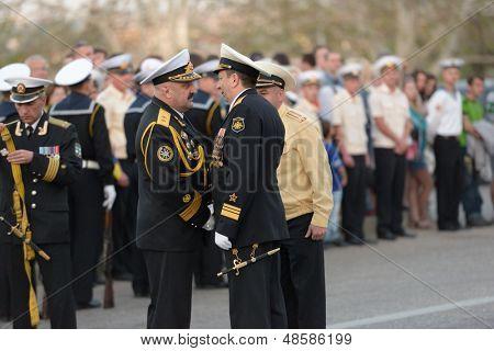SEVASTOPOL, UKRAINE - MAY 7: Vice admirals Fedotenkov, Russia, right and Ilyin, Ukraine, handshakes on the rehearsal of military parade in honor of Victory Day in Sevastopol, Ukraine on May 7, 2013