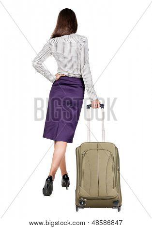 Back view brunette business woman with suitcase looking up. Rear view people collection. backside view person. Isolated over white background. languid girl in heels looks into distance