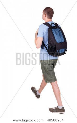 back view walking man with backpack. brunette guy in motion. backside view person. Rear view people collection. Isolated over white background. young man goes to side of a rolling travel bag on wheels