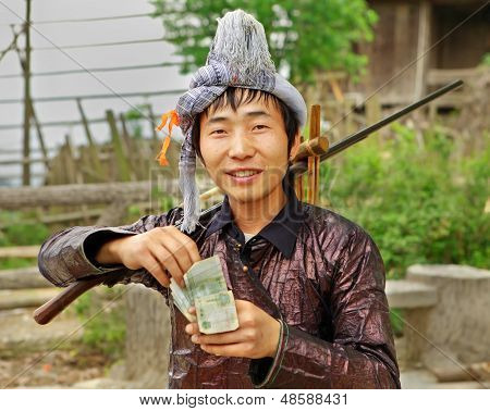 Ethnic Miao, Hmong Chinese. Guizhou Province, China. The Man Miao Ethnic Group, Holding A Musket