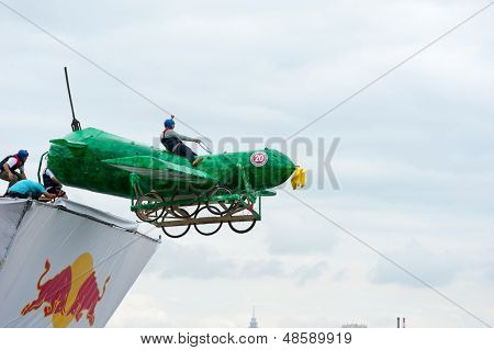 MOSCOW - JULY 28: Competitors perform a flight on Red Bull Flugtag on July 28, 2013 in Moscow. Red Bull Flugtag is an event in which competitors attempt to fly homemade human-powered flying machines