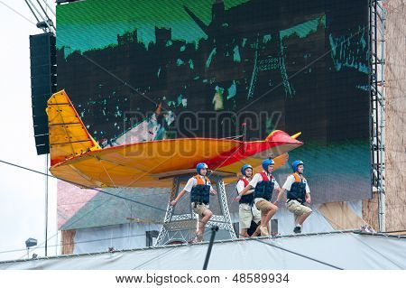 MOSCOW - JULY 28: Competitors perform a show on Red Bull Flugtag on July 28, 2013 in Moscow. Red Bull Flugtag is an event in which competitors attempt to fly homemade human-powered flying machines