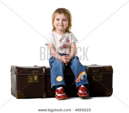 Baby Sitting In A Old Suitcase