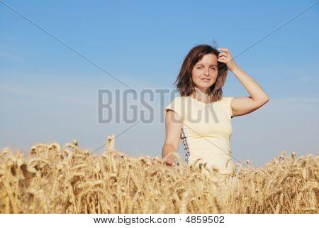 Young Woman Has Pleasure Time In Grain Field