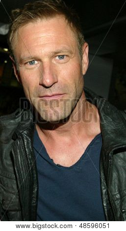 "SAN DIEGO, CA - JULY 19: Actor Aaron Eckhart arrives at the Lionsgate booth for an ""I, Frankenstein"" poster signing for fans during the 2013 Comic Con convention on July 19, 2013 in San Diego, CA."