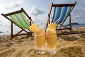 stock photo of pina-colada  - Vacation with Pina Colada on Tropical Beach - JPG