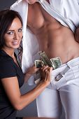stock photo of stripper  - Smiling girl puts dollars in stripper - JPG