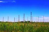 foto of mast  - Radio masts system on the blue sky background