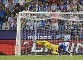 MALAGA, SPAIN. 19/09/2010.  Rodrigo Galatto the Malaga goalkeeper makes a save during the La Liga ma