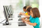 stock photo of schoolgirl  - group elementary school students in computer class - JPG