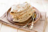 stock photo of flat-bread  - India vegetarian food plain chapatti roti or Flat bread - JPG