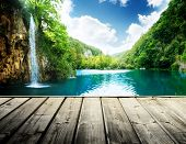 stock photo of deep  - waterfall in deep forest of croatia and wood pier - JPG