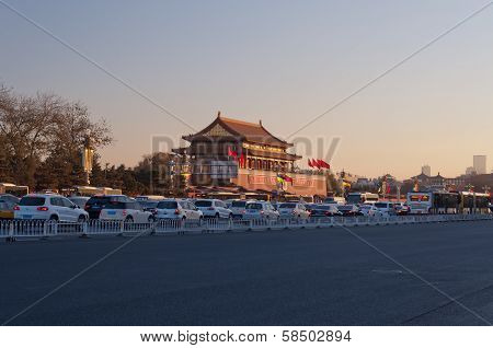 Tienanmen Gate (the Gate Of Heavenly Peace) With Passing Traffics At Sunrise. Beijing. China