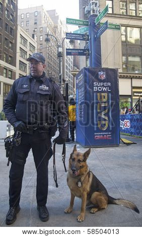 NYPD transit bureau K-9 police officer and K-9 German Shepherd providing security on Broadway