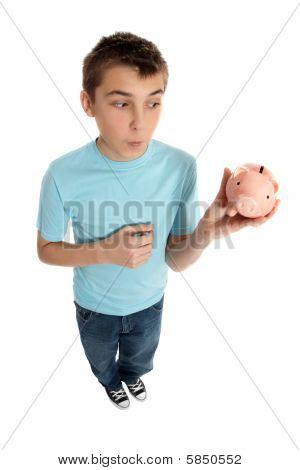 Boy Looking At Money Box