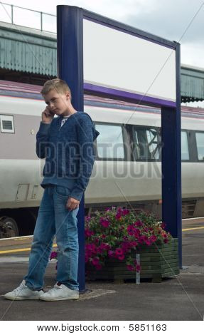 Young Boy On Mobile Phone