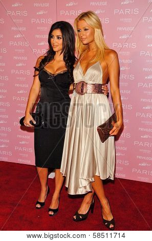 HOLLYWOOD - AUGUST 18: Kimberly Kardashian and Paris Hilton at the party celebrating the launch of Paris Hilton's Debut CD