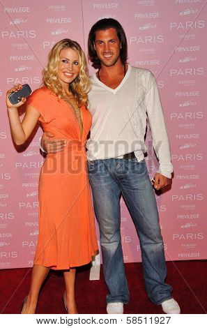 HOLLYWOOD - AUGUST 18: Willa Ford and friend at the party celebrating the launch of Paris Hilton's Debut CD