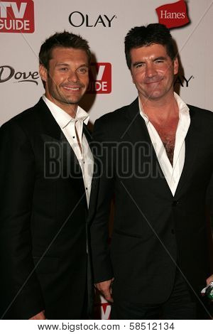 HOLLYWOOD - AUGUST 27: Ryan Seacrest and Simon Cowell at the TV Guide Emmy After Party at Social August 27, 2006 in Hollywood, CA.