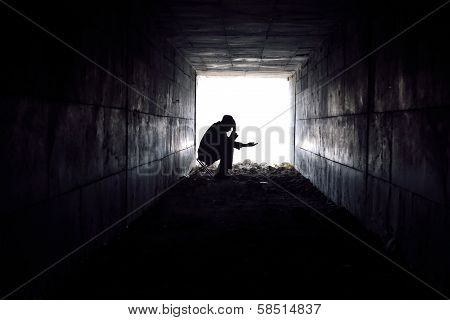 Sad Man Sitting In The Tunnel