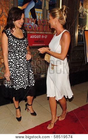 HOLLYWOOD - AUGUST 15: Jennifer Tilly and Nicolette Sheridan at the Los Angeles Premiere of Dirty Rotten Scoundrels on August 15, 2006 at Pantages Theatre in Hollywood, CA.
