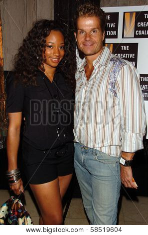 HOLLYWOOD - AUGUST 15: Monique Coleman and Louis van Amstel at the Los Angeles Premiere of Dirty Rotten Scoundrels on August 15, 2006 at Pantages Theatre in Hollywood, CA.