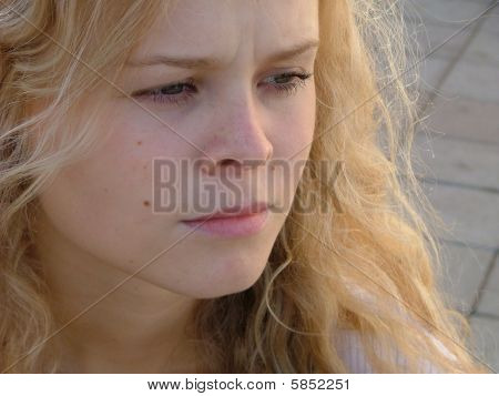 Thoughtful Young Blond Woman