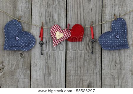 Blue and red country hearts hanging on clothesline