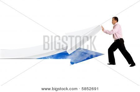Business Man Pushing An Arrow