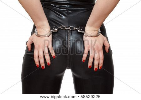 Sexy Dominatrix Hands On Ass In Handcuffs Closeup Isolated