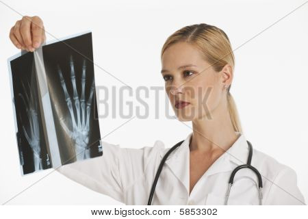 Female Doctor Holding Up Xray
