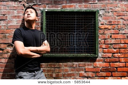 Lonely Asian Man Against Old Window