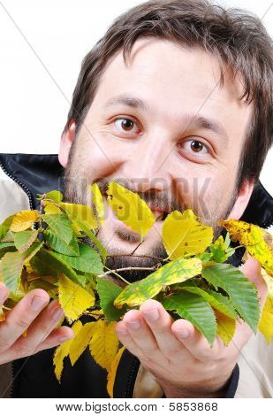 Young Man Holding Fall Leaves In Hands