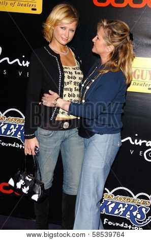 LOS ANGELES - APRIL 12: Paris Hilton and Kathy Hilton at the 3rd Annual Bodog Celebrity Poker Invitational at Barker Hangar on April 12, 2006 in Santa Monica, CA.