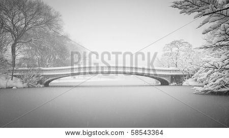 Snow On Bow Bridge And The Lake, Central Park, New York