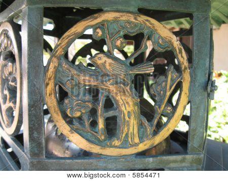 birds in bronze lantern