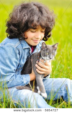 Very Cute Little Girl With Cat On Meadow