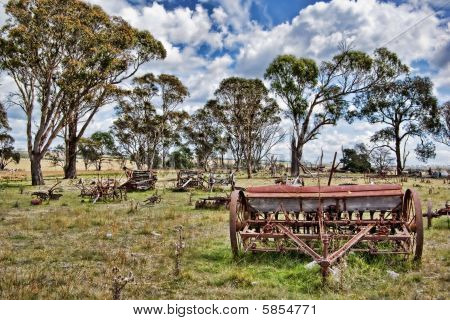 Old Farm Machinery In Field