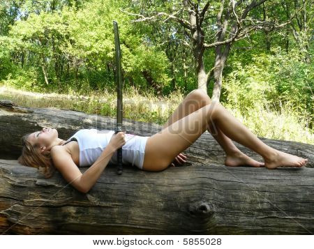Girl Dreams On A Log In Wood