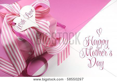 Beautiful Pink Gift On Pink And White Background With Sample Text And Copy Space For Your Text Here