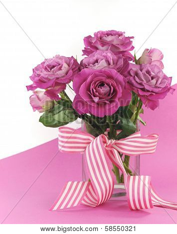 Beautiful Pink Gift Of Roses On Pink And White Background With Sample Text And Copy Space For Your T