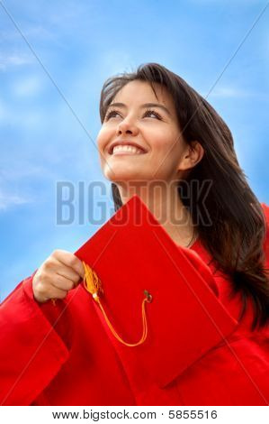 Female Graduate Throwing The Mortarboard
